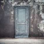 Old,Blue,Wooden,Door,In,Dark,Concrete,Wall,,Empty,Abstract